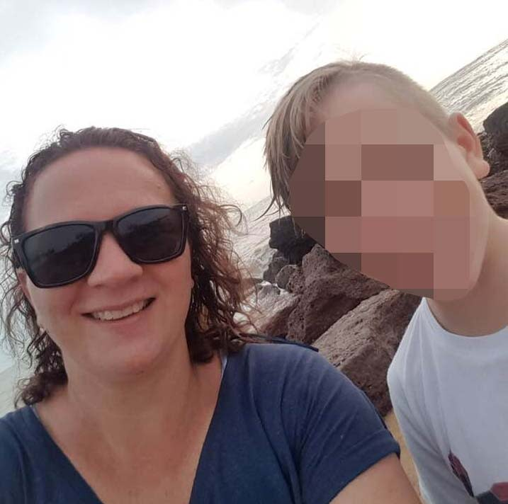 Donna Dwyer pictured in sunglasses with one of her sons.