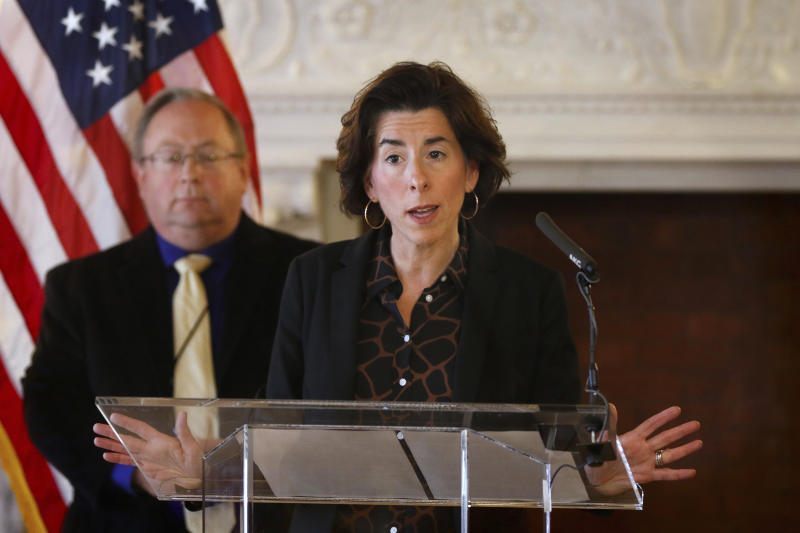 FILE - In this Sunday, March 22, 2020 file photo, Gov. Gina Raimondo gives an update on the coronavirus during a news conference in the State Room of the Rhode Island State House in Providence, R.I. Amid the continuing COVID-19 coronavirus outbreak, Raimondo is warning that the virus' widening economic fallout could lead to government layoffs in a state that already was facing a $200 million shortfall. Rhode Island lawmakers also approved borrowing up to $300 million to help the state cover its bills. (Kris Craig/Providence Journal via AP, Pool)