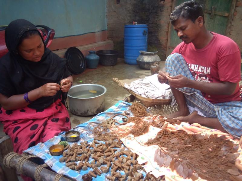 Hussain Jadupatiya and his wife working on dokra art-based jewellery