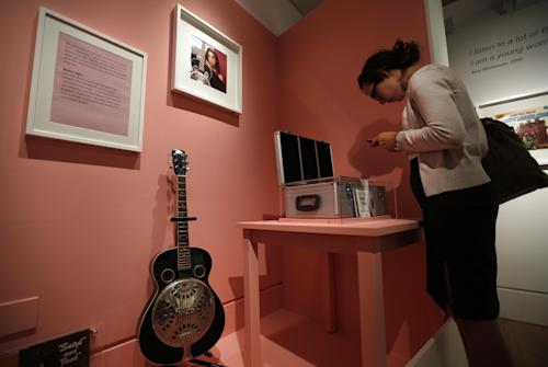 "A guitar that used to belong to Amy Winehouse is seen at an exhibition entitled ""Amy Winehouse: A Family Portrait"" in London's Jewish Museum, Tuesday, July 2, 2013. The exhibition aims to reveal an intimate side of the late soul diva. She was, in the words of her older brother Alex, ""simply a little Jewish kid from North London with a big talent."" It includes a trove of items from the singer's London childhood, her stage-school years and her short but stratospheric career in music _ from her first guitar to a posthumous Grammy Award. By the time she died in 2011 at the age of 27, Winehouse was a star, a larger-than-life figure whose battles with drugs and alcohol, splashed across front pages around world, sometimes seemed to overshadow her talent. (AP Photo/Lefteris Pitarakis)"