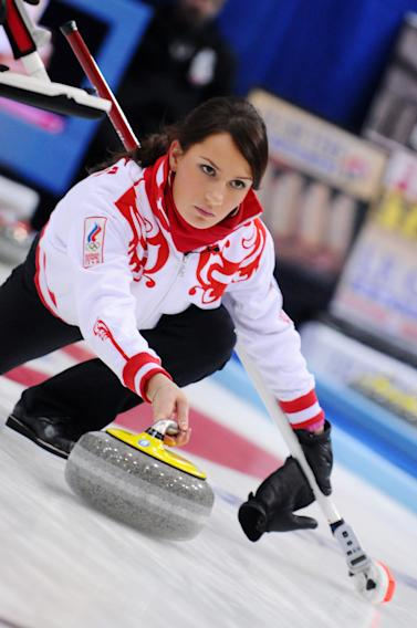 Anna Sidorova of Russia plays a stone against Sweden during the women's semi-final match of the European Curling Championships 2010, at the Palladium Ice Arena, in Champery, Switzerland, Friday, Dec. 10, 2010. (AP Photo/KEYSTONE, Sebastien Anex)