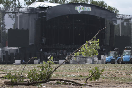 A fallen branch of a tree is pictured in front of the main stage at the festival campsite near Hasselt, 50 miles (80 kilometers) east of Brussels, Friday Aug. 19, 2011. Five people died in a fierce thunderstorm on Thursday, that mangled tents and downed trees and scaffolding at the open-air music festival PukkelPop in Belgium. Organizers canceled the annual four-day festival. (AP Photo/Yves Logghe)