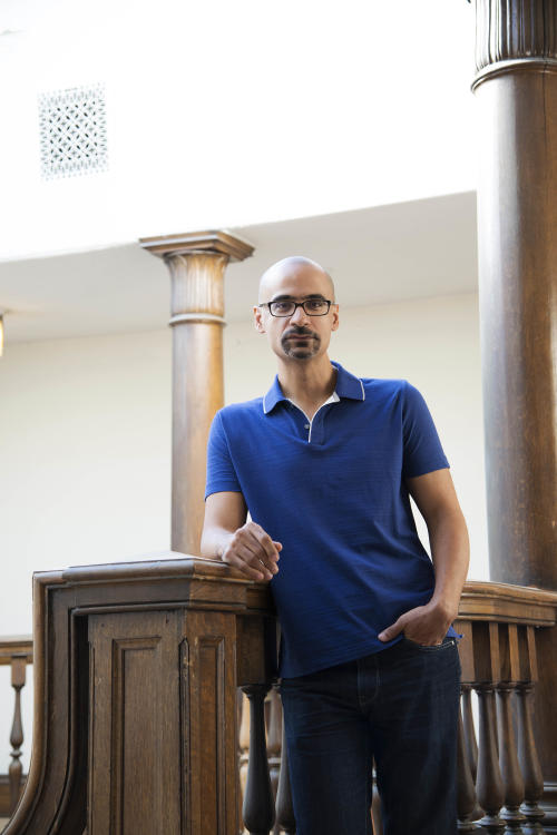 """In this Sept. 20, 2012 photo provided by the Chicago-based John D. and Catherine T. MacArthur Foundation, Junot Diaz, 43, a fiction writer at the Massachusetts Institute of Technology who uses raw, vernacular dialogue and spare, unsentimental prose to draw readers into the various and distinct worlds that immigrants must straddle, is seen in Cambridge, Mass. Diaz is among 23 recipients of this year's MacArthur Foundation """"genius grants."""" (AP Photo/Courtesy of theJohn D. and Catherine T. MacArthur Foundation, Tsar Fedorsky)"""