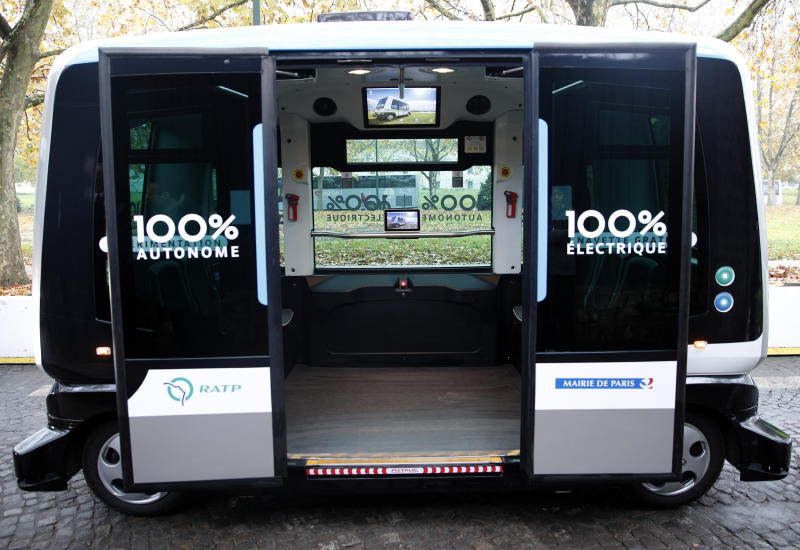 FILE - This Nov. 17, 2017, file photo shows a view inside an electric driverless shuttle produced by EasyMile, during an experiment, in Paris. The U.S. government's highway safety agency has ordered an autonomous shuttle company to stop carrying passengers in 16 U.S. cities after a mysterious braking problem occurred in Columbus, Ohio. The National Highway Traffic Safety Administration says the suspension will remain in place while it examines safety issues with the low-speed shuttles operated by France-based EasyMile. (AP Photo/Christophe Ena, File)