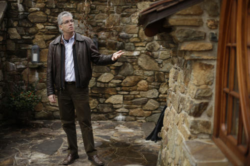 """Architect Peter Archer speaks during and interview with the Associated Press at the """"Hobbit House"""" Tuesday, Dec. 11, 2012, in Chester County, near Philadelphia. Archer has designed a """"Hobbit House"""" containing a world-class collection of J.R.R. Tolkien manuscripts and memorabilia. (AP Photo/Matt Rourke)"""