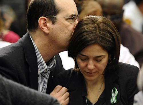 David and Francine Wheeler, parents of Sandy Hook Elementary School shooting victim Benjamin Wheeler, embrace, during a gun violence conference in Danbury, Conn., Thursday, Feb. 21, 2013. The conference, held near Newtown, Conn. where 26 lives were lost in the Sandy Hook Elementary School shooting, was organized by members of the state's congressional delegation is to push President Barack Obama's gun control proposals. (AP Photo/Jessica Hill)