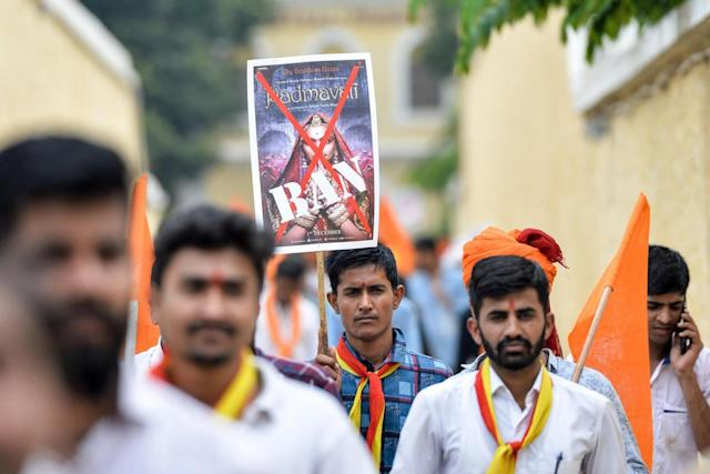 Members and activists of the Karnataka wing of Rashtriya Rajput Karni Sena caste organisation hold posters demanding a ban on Padmavathi (AFP/Getty)