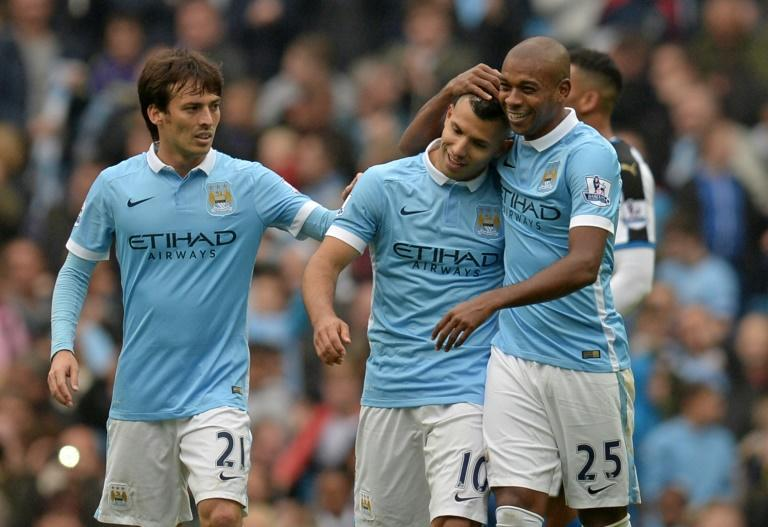 Manchester City's Sergio Aguero (C) celebrates with teammates Fernandinho (R) and David Silva after scoring a goal during their English Premier League match against Newcastle United, at the Etihad Stadium in Manchester, on October 3, 2015