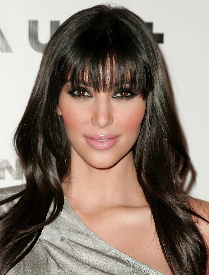 """<p>""""Should I get bangs?"""" - That is literally the sentence I hear as soon as I look at this picture of Kim from back in 2008. </p><p>Still rocking her signature smokey eye, which is only enhanced by her lash-skimming fringe</p>"""