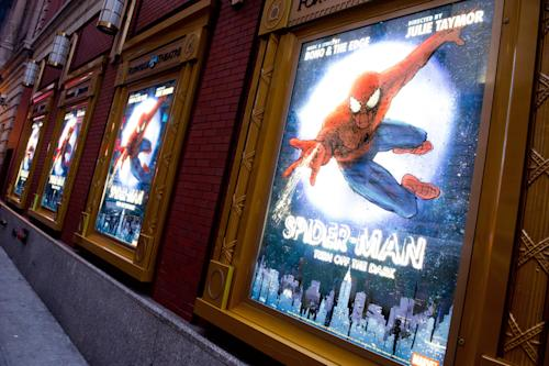 "FILE - In this Dec. 22, 2010 file photo, posters for the Broadway musical ""Spider-Man Turn: Off the Dark"" hang outside the Foxwoods Theatre in New York. A spokesman for the show says an actor on the set of the Broadway musical was injured during a night performance, Thursday, Aug. 15, 2013. The performance was halted. The actor, who was taken to Bellevue Hospital with a serious leg injury, was not identified. (AP Photo/Charles Sykes, File)"