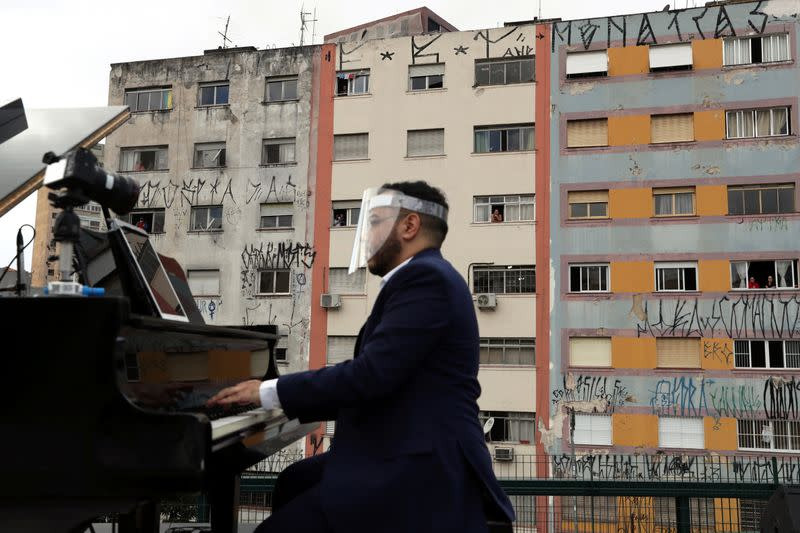 Pianist Rodrigo Cunha serenades from an open truck, in Sao Paulo