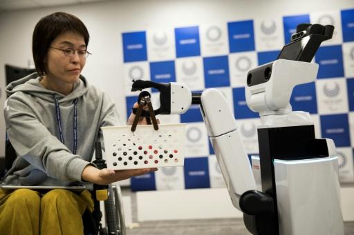 The robots are designed to help out disabled people enjoying the Games