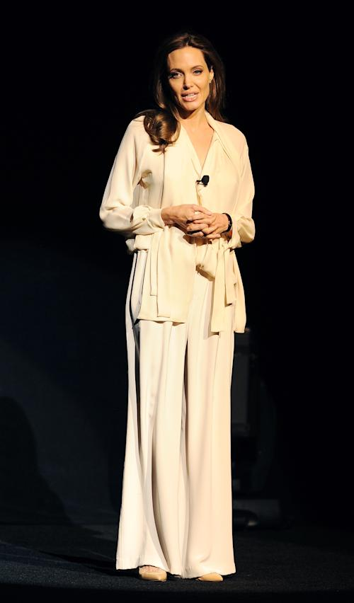 "Angelina Jolie, director of the upcoming film ""Unbroken,"" makes a surprise appearance onstage during a Universal Pictures studio presentation at CinemaCon 2014 on Tuesday, March 25, 2014 in Las Vegas. (Photo by Chris Pizzello/Invision/AP)"