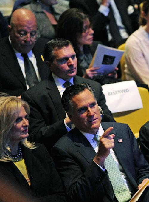 In this image released by CBS, Republican presidential candidate, former Massachusetts Gov. Mitt Romney, right, and his wife, Ann, attend the CBS News memorial service for Mike Wallace at Jazz at Lincoln Center in New York on Tuesday, May 1, 2012. Wallace died at age 93 on April 7. (AP Photo/CBS, John Paul Filo)