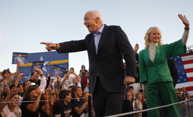 Republican presidential nominee John McCain, left, and his wife, Cindy, arrive at a campaign rally in Durango, Colorado, in October 2008.  (Brian Snyder/Reuters)