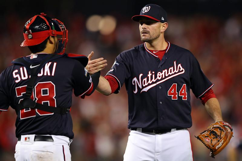 WASHINGTON, DC - OCTOBER 07: Daniel Hudson #44 and Kurt Suzuki #28 of the Washinton Nationals celebrate after the Nationals defaeted the Los Angeles Dodgers in Game 4 of the NLDS at Nationals Park on Monday, October 7, 2019 in Washington, District of Columbia. (Photo by Alex Trautwig/MLB Photos via Getty Images)