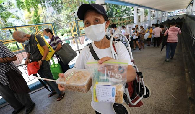 Lily is one of hundreds of homeless people who rely on free meals provided by charities and NGOs such as ImpactHK. Photo: May Tse