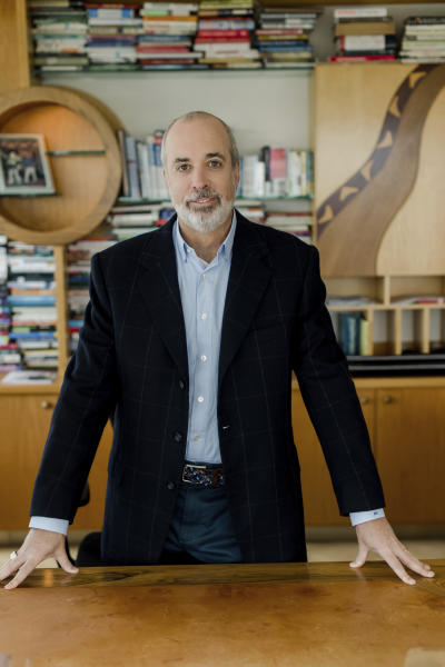 In this March 2020 photo provided by Edelman Financial Engines, Ric Edelman poses in his office in Fairfax, Virginia. (Liz Banfield/Edelman Financial Engines via AP)