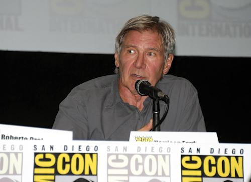 "Actor Harrison Ford answers a question at the ""Ender's Game"" panel on Day 2 of the 2013 Comic-Con International Convention on Thursday, July 18, 2013 in San Diego. (Photo by Denis Poroy/Invision/AP)"