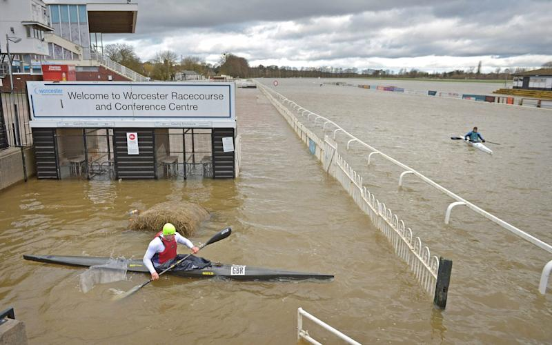 The deluge that flooded Worcester racecourse was good news only for the town's canoe club - Jacob King/PA
