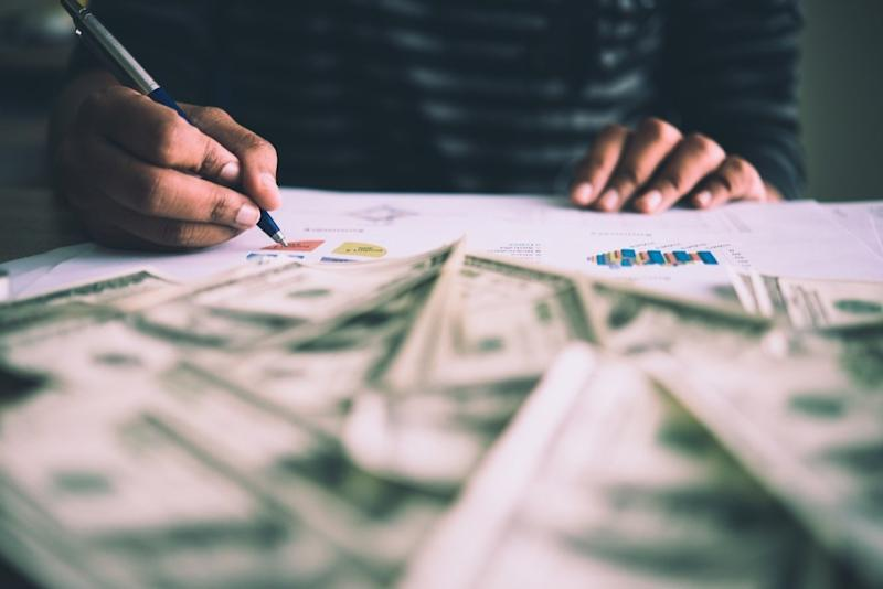 man counting money, empty nest