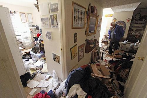Louis Ponce, brother-in-law of Bobbi Salinas-Norman, walks through the apartment on May 10, 2013, where Salinas-Norman was found dead. Ponce discovered The remains of Salinas-Norman, a Chicana activist, teacher and author, last week and authorities say she may have been dead for more than a year. (AP Photo/The Santa Fe New Mexican,Luis Sanchez Saturno)