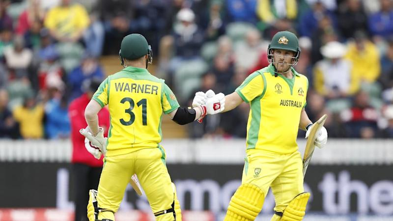 Aaron Finch celebrates with fellow opener David Warner during Australia's innings against Pakistan
