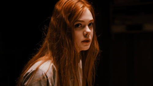"This publicity photo released by A24 Films shows Elle Fanning as Ginger in a scene from the film, ""Ginger and Rosa,"" directed by Sally Potter. (AP Photo/A24 Film, Nicola Dove)"