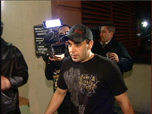 """FILE - This Jan. 31, 2008 video frame grab release by AP Television shows Sam Lutfi leaving UCLA medical center after visiting Britney Spears in Los Angeles. Testimony is scheduled to begin on Tuesday, Oct. 16, 2012, in a libel, defamation and breach of contract case filed against Spears and her parents by the singer's former confidante and manager, Osama """"Sam"""" Lutfi. He is seeking a share of Spears' fortune and claims he has was unfairly vilified by the singer's mother in her 2008 book, which accused Lutfi of drugging and isolating the pop star before she had to be hospitalized. (AP Photo/APTN, File)"""
