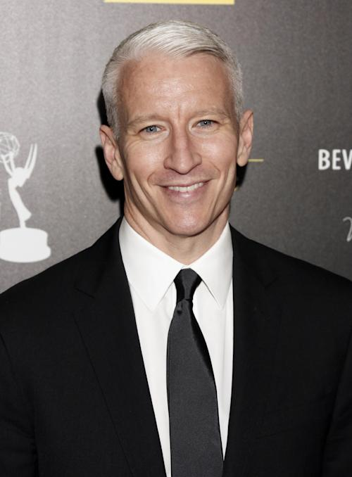 "FILE - This June 23, 2012 file photo shows CNN's Anderson Cooper as he arrives at the 39th Annual Daytime Emmy Awards at the Beverly Hilton Hotel in Beverly Hills, Calif. Cooper's daytime talk show will be wrapping after two seasons. Warner Bros. said Monday, Oct. 29, 2012, that the marketplace made it increasingly difficult for ""Anderson Live"" to ""break through"" to viewers despite format changes. (Photo by Todd Williamson/Invision/AP, file)"