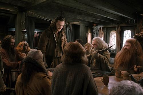 "This image released by Warner Bros. Pictures shows Luke Evans, standing, in a scene from ""The Hobbit: The Desolation of Smaug."" (AP Photo/Warner Bros. Pictures)"