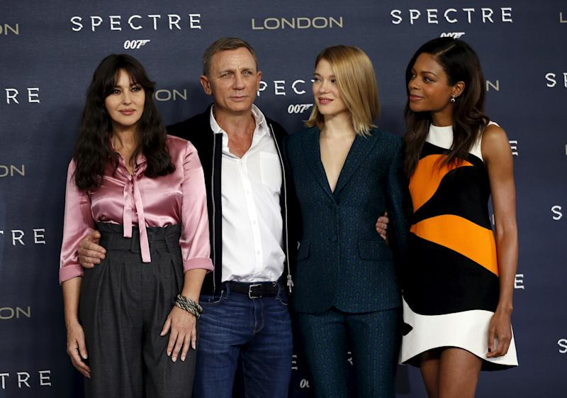 """Actors Monica Bellucci, Daniel Craig, Lea Seydoux and Naomie Harris (L-R) pose during a photocall for the new James Bond film """"Spectre"""" in central London, Britain October 22, 2015. REUTERS/Stefan Wermuth"""