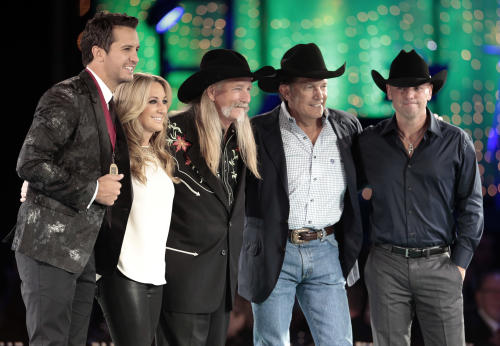 Dean Dillon, center, is joined by Luke Bryan, left, Lee Ann Womack, second from left, George Strait, second from right, and Kenny Chesney, right, for a photo before the start of the BMI Country Awards on Tuesday, Nov. 5, 2013, in Nashville, Tenn. Dillion is being honored as a BMI Icon at the show. (AP Photo/Mark Humphrey)