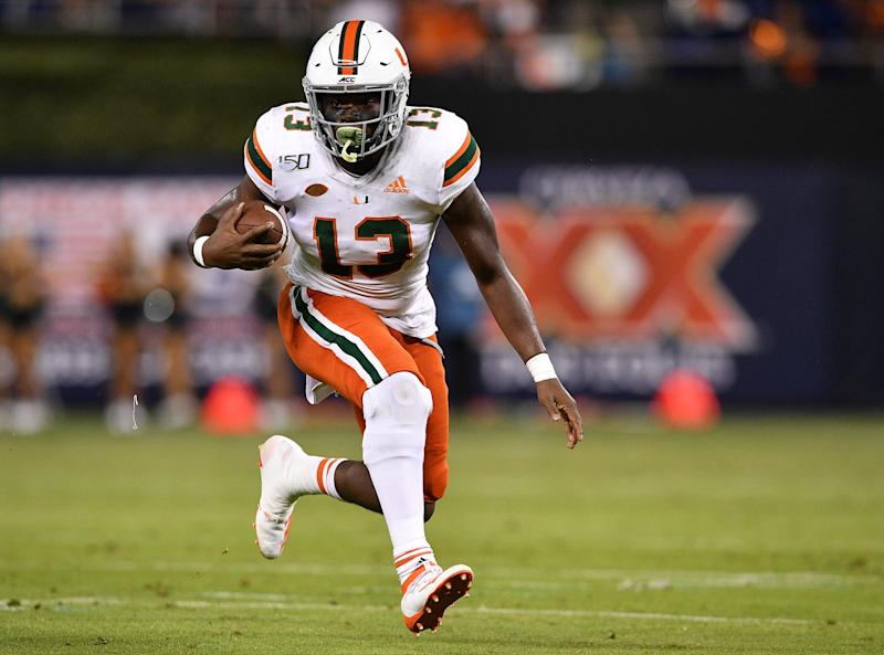 Miami (Fla.) RB DeeJay Dallas turned to a sports psychiatrist to help his fumbling issue. (Photo by Mark Brown/Getty Images)