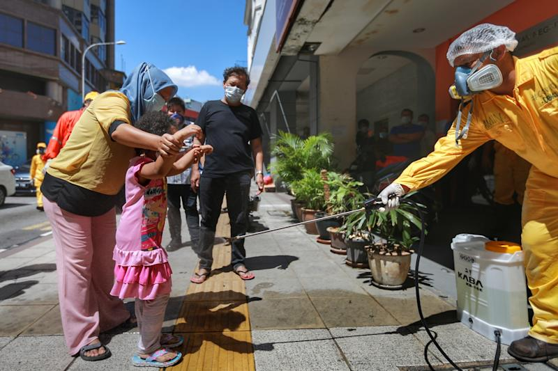 A DBKL personnel sprays disinfectant at a public area in Kuala Lumpur April 4, 2020. ― Picture by Ahmad Zamzahuri