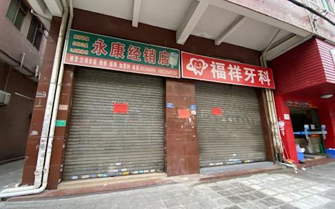 Rows of empty stores and restaurants, peppered with for lease and sale signs, are common sights in Dongguan. Photo: He Huifeng