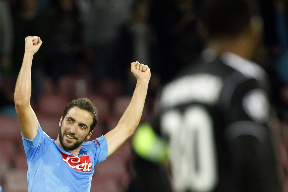 Napoli's Gonzalo Higuain celebrates his goal next to Olympique Marseille's goalkeeper Steve Mandanda during their Champions League soccer match at San Paolo stadium in Naples
