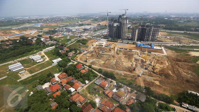Suasana pembangunan kota baru berskala internasional di Kota Meikarta, Lippo Cikarang, Sabtu (13/05). Pembangunan kota tersebut telah menyerap ribuan tenaga kerja di Cikarang. (Liputan6.com/Fery Pradolo)