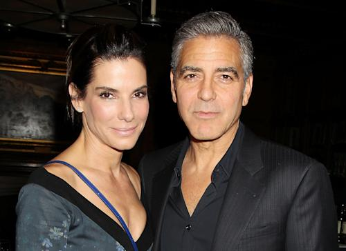 "This image released by Starpix shows Sandra Bullock, left, and George Clooney at luncheon honoring the film ""Gravity,"" and hosted by The Peggy Siegal Company and Warner Brothers Pictures at The Explorers Club, Wednesday, Oct. 2, 2013 in New York. (AP Photo/Starpix, Dave Allocca) -PICTURED: Sandra Bullock and George Clooney -PHOTO by: Dave Allocca/Startraksphoto.com -File name: DA560447.JPG -Location: The Explorers Club Editorial - Rights Managed Image - Please contact www.startraksphoto.com for licensing fee Startraks Photo New York, NY For licensing please call 212-414-9464 or email sales@startraksphoto.com"