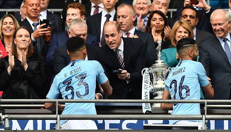 Britain's Prince William, Duke of Cambridge (C) hands winner's medals to Manchester City's Brazilian striker Gabriel Jesus (L) and Manchester City's Algerian midfielder Riyad Mahrez after the English FA Cup final football match between Manchester City and Watford at Wembley Stadium in London, on May 18, 2019. - Manchester City beat Watford 6-0 at Wembley to claim the FA Cup. (Photo by Daniel LEAL-OLIVAS / AFP) / NOT FOR MARKETING OR ADVERTISING USE / RESTRICTED TO EDITORIAL USE (Photo credit should read DANIEL LEAL-OLIVAS/AFP/Getty Images)