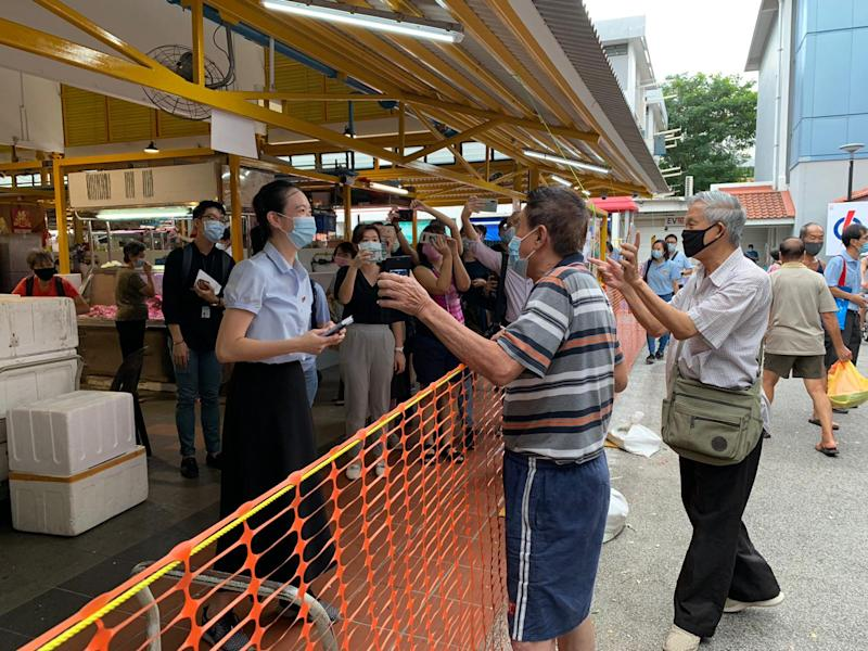 Workers' Party candidate for East Coast GRC Nicole Seah speaking to residents at Bedok North on Wednesday morning (1 July).