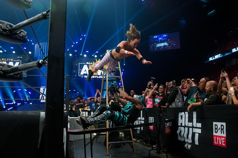 """The Young Bucks are seen during their match against the Lucha Bros. at All Elite Wrestling's """"All Out"""" event in August. (Photo by Ricky Havlik/Courtesy of AEW)"""
