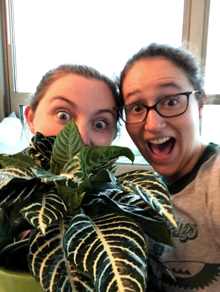 In this May 2019 photo, Molly Sprayregen, right, and her fiancé Meredith Bennett-Swanson celebrate the purchase of one of their new house plants in Chicago, Ill. (Molly Sprayregen via AP)