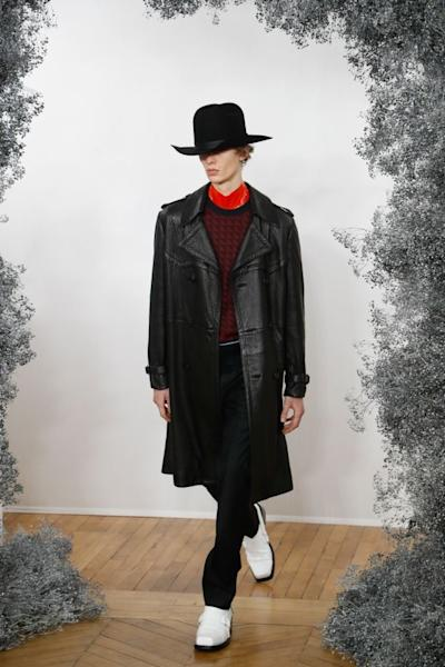 The Givenchy style extends from chic glamour to rock and roll. It includes this long leather coat, wide-brimmed hat and square-toed boots. Paris, January 16, 2020