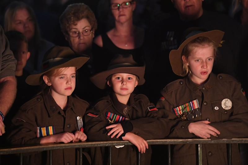 Crowds gather during the Dawn Service at the Shrine of Remembrance in Melbourne for Anzac Day 2019. Source: AAP