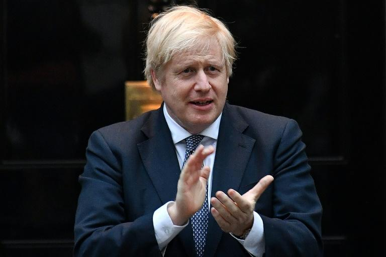 Britain's Prime Minister Boris Johnson makes his first appearance at a daily government briefing since his own battle with COVID-19