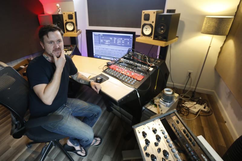 In this Sept. 30, 2019 photo, Andreas Magnusson, a music producer who has been in the US for over 30 years, poses in his studio in Richmond, Va.  Magnusson is among the oldest immigrants enrolled in Deferred Action for Childhood Arrivals, known as DACA. He came to the U.S. from Sweden when he was a toddler. His mother had a student visa and eventually found an employer who was sponsoring the two, but an immigration lawyer botched their case, and Magnusson, already an adult with a growing business, a home and a car, was left without legal status. (AP Photo/Steve Helber)