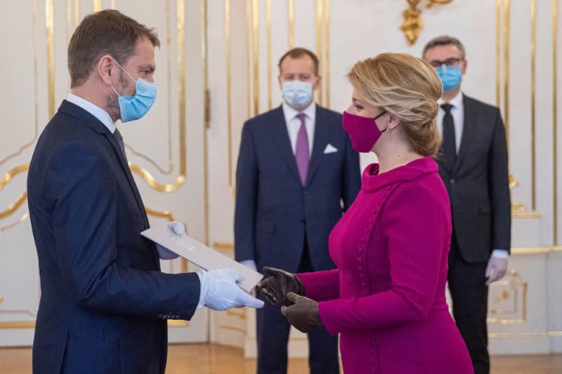 Slovakia's President Zuzana Caputova and Prime Minister Igor Matovic wearing protective face masks attend the cabinet's inauguration at Presidential Palace in Bratislava