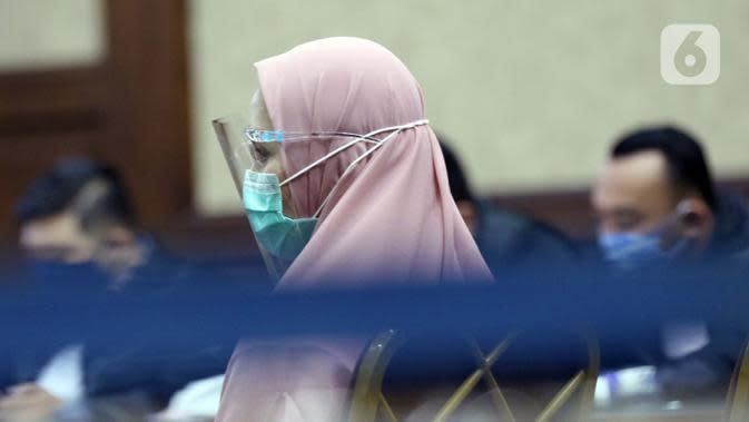 Jaksa Pinangki Sirna Malasari saat menjalani sidang perdana di Pengadilan Tipikor Jakarta, Rabu (23/9/2020). Pinangki Sirna Malasari didakwa dalam kasus dugaan korupsi dan tindak pidana pencucian uang terkait kepengurusan fatwa untuk Djoko Tjandra di Mahkamah Agung, (Liputan6.com/Helmi Fithriansyah)