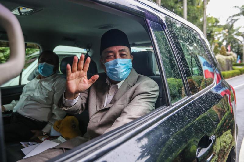 Sabah Bersatu chief Datuk Hajiji Noor leaves Istana Negeri Sabah in Kota Kinabalu September 28, 2020. ― Picture by Firdaus Latif